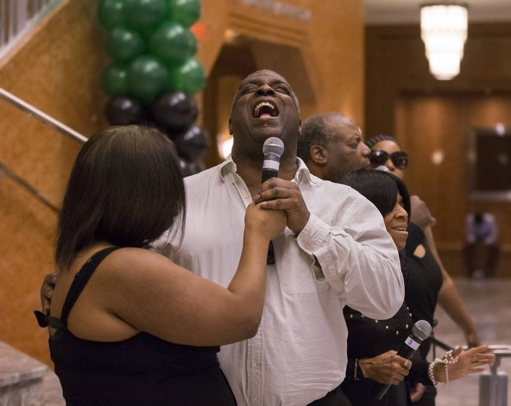 William Stoakley, middle, a choir member from The Blind Center of Nevada, performs during an event in coordination with Black History Month on Wednesday, Feb. 13, 2019, at The Smith Center, in Las ...