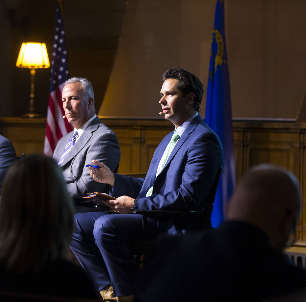 National Rifle Association state legislative liaison Dan Reid, right, speaks during a town hall discussion on Question 1 at the Mob Museum in Las Vegas on Thursday, Sept. 29, 2016. Question 1 is t ...