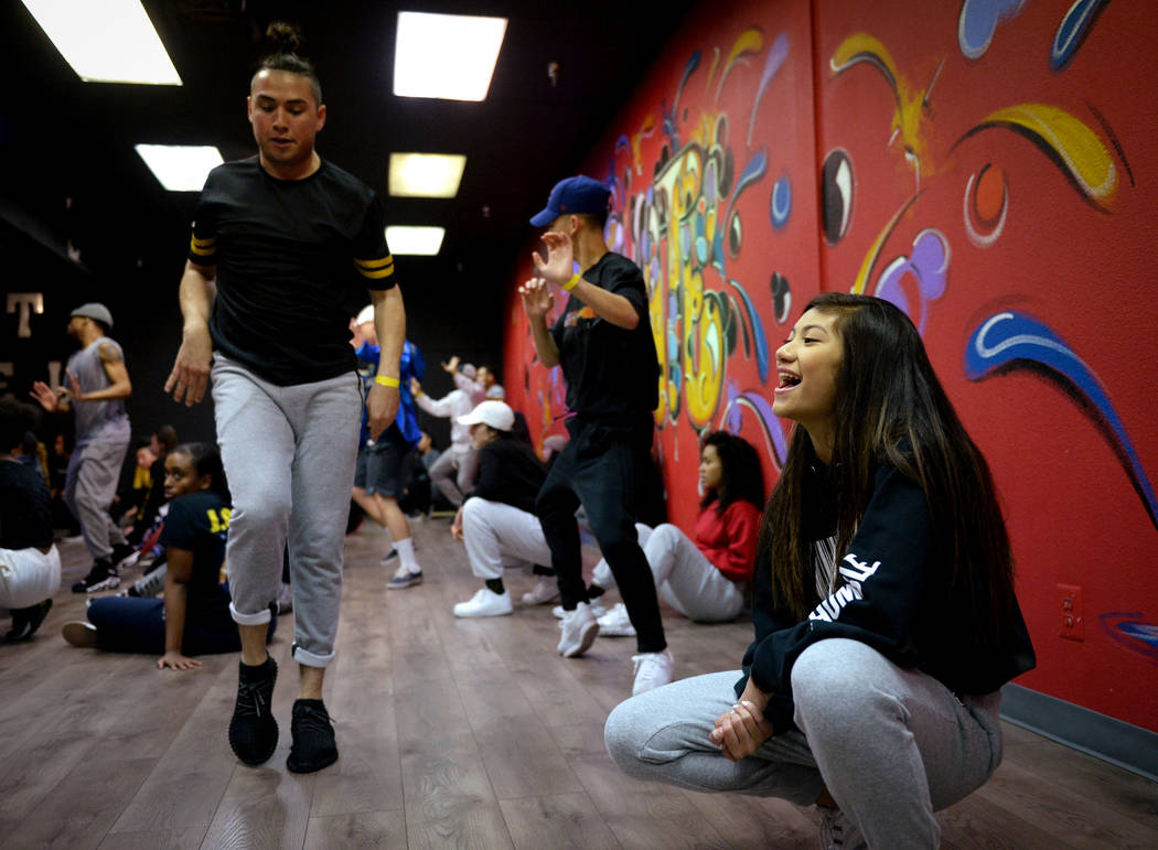 Jayna Hughes, 13, cheers on the male dancers as they practice a dance they are learning in a training class at Elevate Dance Center in Las Vegas, Tuesday, Feb. 19, 2019. (Caroline Brehman/Las Vega ...