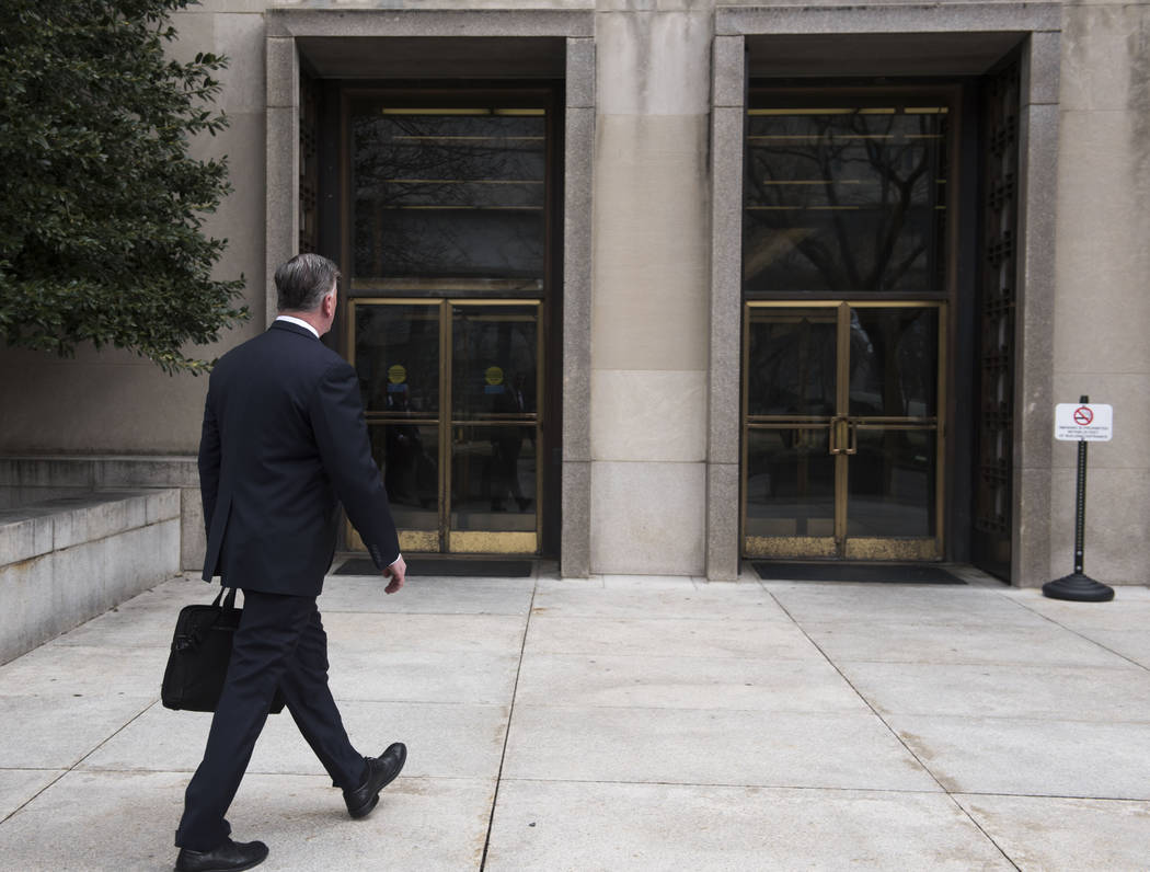 Kevin Downing, defense attorney for Paul Manafort, walks to the entrance of federal court on Wednesday, Feb. 13, 2019 in Washington. (AP Photo/Kevin Wolf)