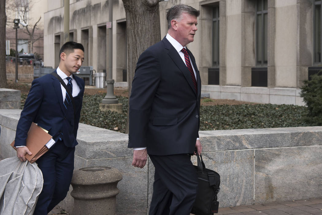 Kevin Downing, Paul Manafort's defense attorney, right, walks to the entrance of federal court on Wednesday, Feb. 13, 2019 in Washington. At left is attorney Tim Wang, another member of the defens ...