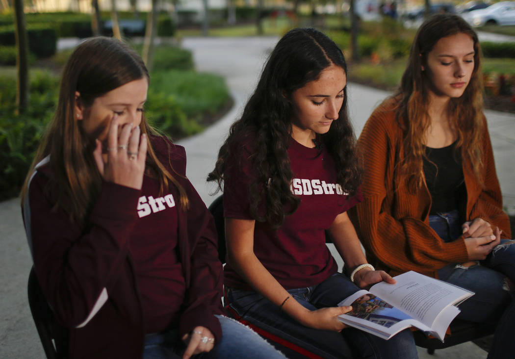 "Brianna Fisher, 16, left, Leni Steinhardt, 16, center, and Brianna Jesionowski sit during an interview with The Associated Press about a new book called ""Parkland Speaks: Survivors from Marjory St ..."
