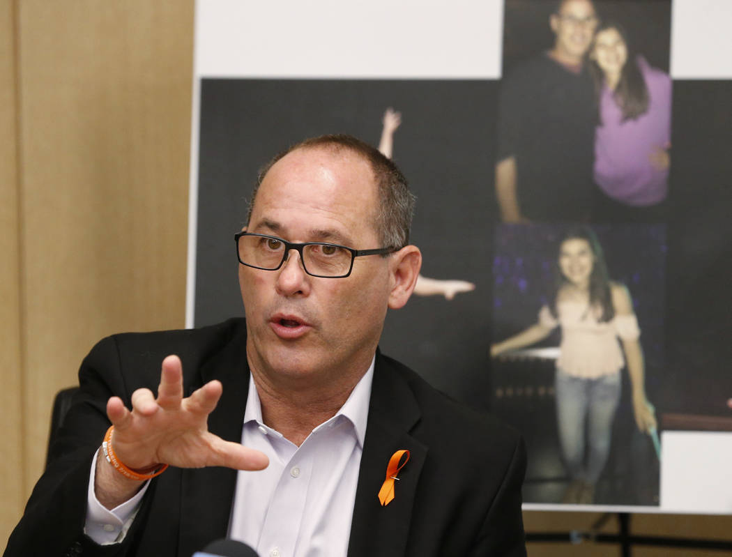 In this May 24, 2018 file photo, Fred Guttenberg speaks at a news conference, in Miami. Guttenberg speaks next to photos of his daughter Jaime Guttenberg, who was one of 17 killed in the Valentine ...
