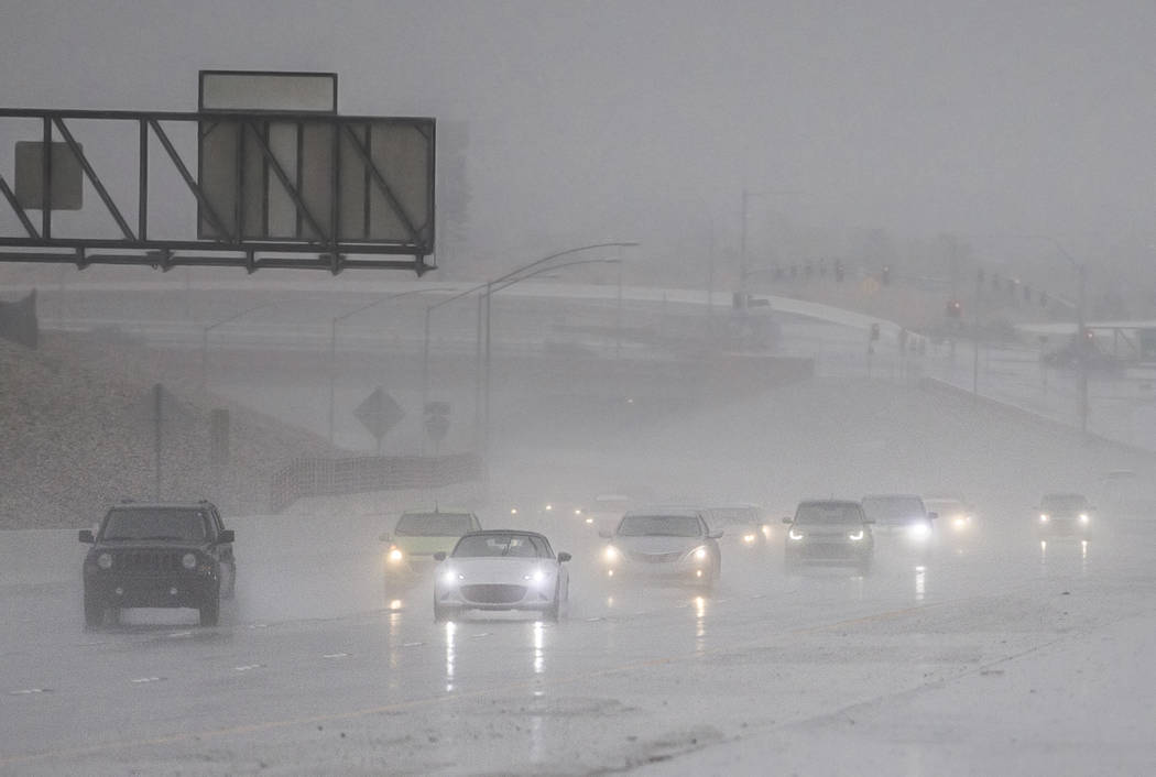 Drivers make their way through heavy rain on the 215 Beltway southbound on Thursday, Feb. 14, 2019, in Las Vegas. (Benjamin Hager Review-Journal) @BenjaminHphoto