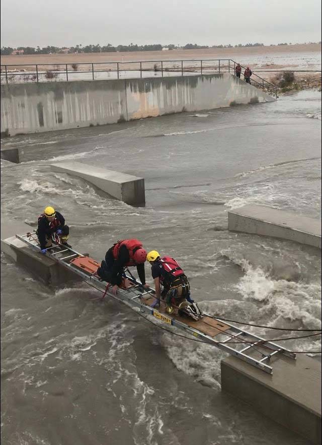The Clark County Fire Department performs a swift-water rescue where one person was trapped in the Durango Wash near 8771 Halcon Ave., Thursday, Feb. 14, 2019. (Jeff Buchanan/Clark County Fire Dep ...