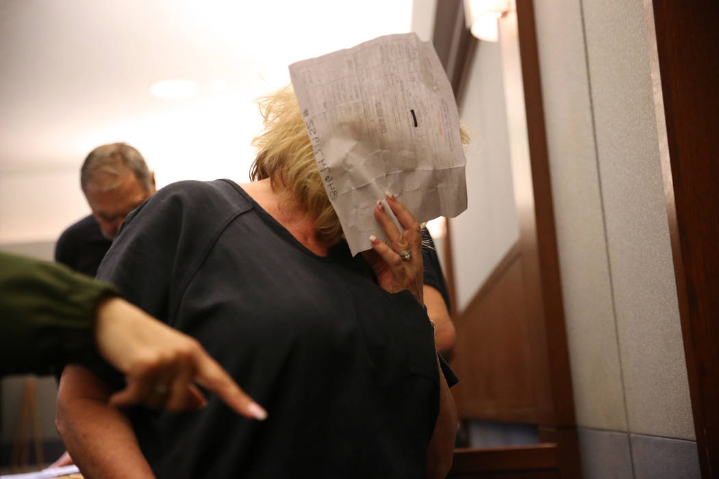 Patricia Chappuis is escorted out the court room following her case hearing at the Regional Justice Center in Las Vegas, Thursday, Feb. 14, 2019. Marcel Chappuis and his wife, Patricia, are operat ...