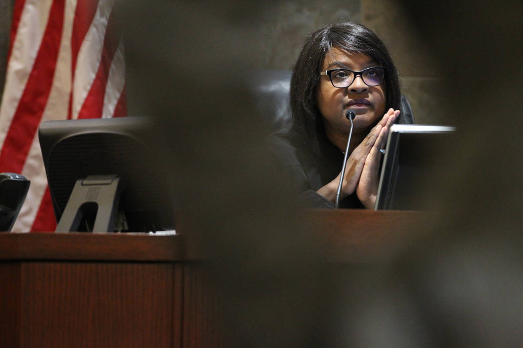 Judge Telia Williams listens to the court hearing for Patricia and husband Marcel Chappuis, not pictured, during a court hearing for his clients at the Regional Justice Center in Las Vegas, Thursd ...