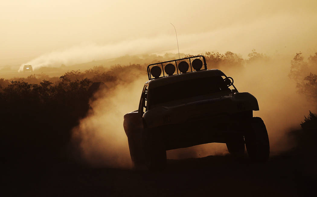 Competitors navigate the desert at sunrise during the Mint 400 off-road race just east of Jean in 2013. (Las Vegas Review-Journal file)