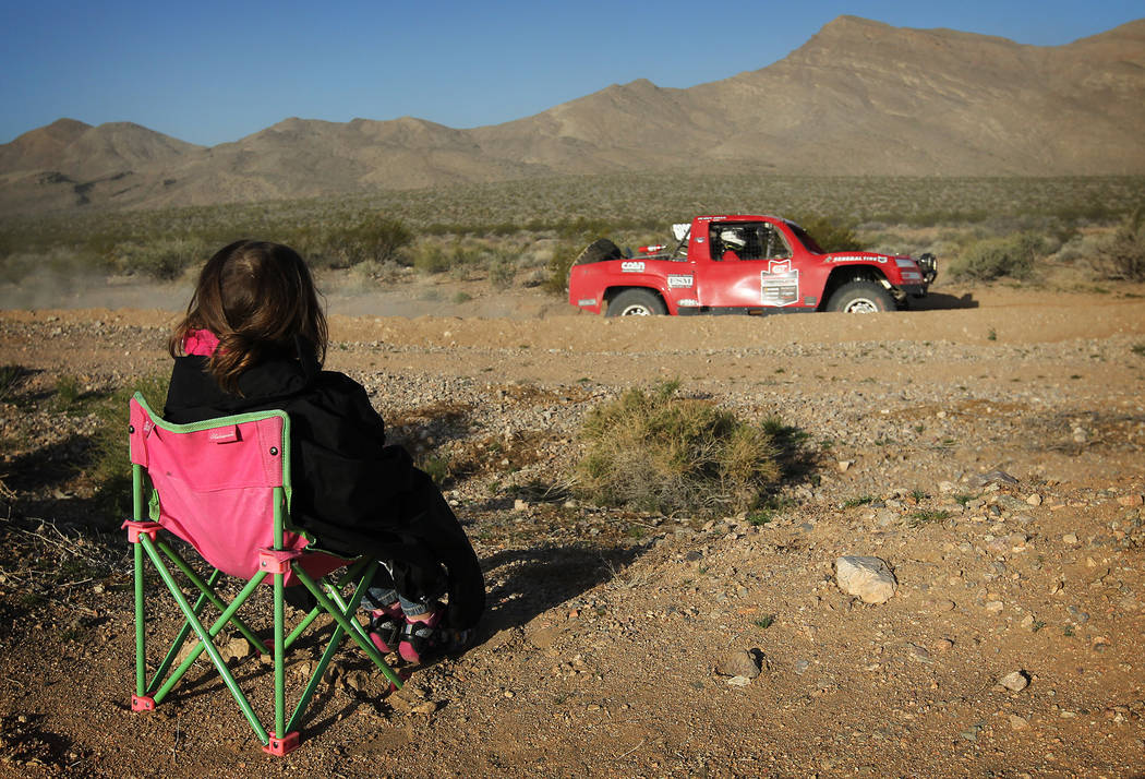Two-year-old Samantha Martinez takes in the action during the Mint 400 off-road race just east of Jean in 2013. (Las Vegas Review-Journal file)