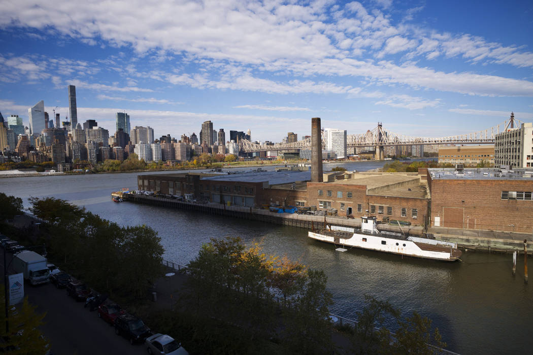 A rusting ferryboat is docked next to an aging industrial warehouse on Long Island City's Anable Basin in the Queens borough of New York, Nov. 7, 2018. Amazon said Thursday, Feb. 14, 2019, that it ...