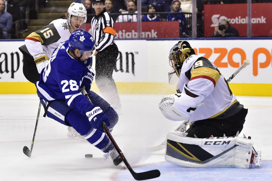 Vegas Golden Knights goaltender Marc-Andre Fleury (29) stops Toronto Maple Leafs right wing Connor Brown (28) on a breakaway during the second period of an NHL hockey game Tuesday, Nov. 6, 2018, i ...