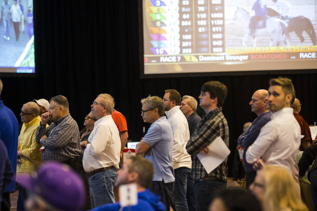 Competitors in the National Handicapping Championship react while watching a race at Treasure Island in Las Vegas on Friday, Feb. 8, 2019. (Chase Stevens/Las Vegas Review-Journal) @csstevensphoto