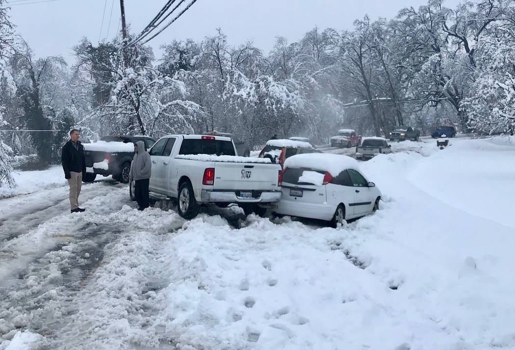 The winter storm caused numerous spin outs and pileups on the road, such as this one on Balls Ferry Road on Wednesday, Feb. 13, 2019 , in south Anderson, Calif. More rain, snow and wind hit the We ...