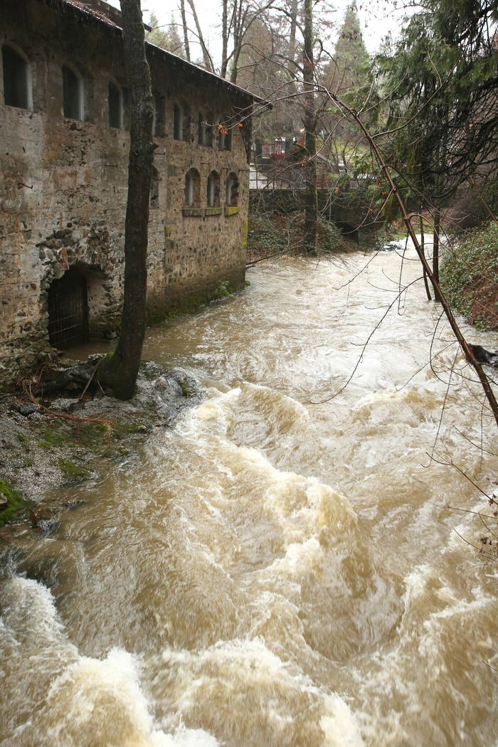 Wolf Creek water flows past the Northstar Mining Museum's power house, Wednesday, Feb. 13, 2019, in Grass Valley, Calif. Widespread roadway flooding occurred north of San Francisco Bay. To the eas ...