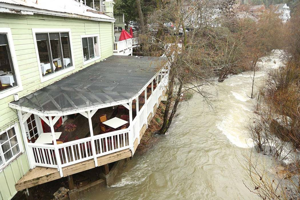 Water from Deer Creek begins to lap at the base of Lefty's Grill in Nevada City, Calif., Wednesday, Feb. 13, 2019. (Elias Funez/The Union via AP)