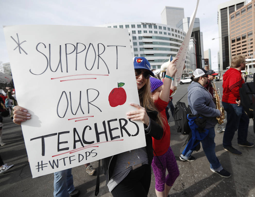 Instructors march to Denver Public Schools headquarters to deliver Valentine Day cards Wednesday, Feb. 13, 2019, in Denver. Teachers walked off their jobs Monday, the first strike by teachers in D ...