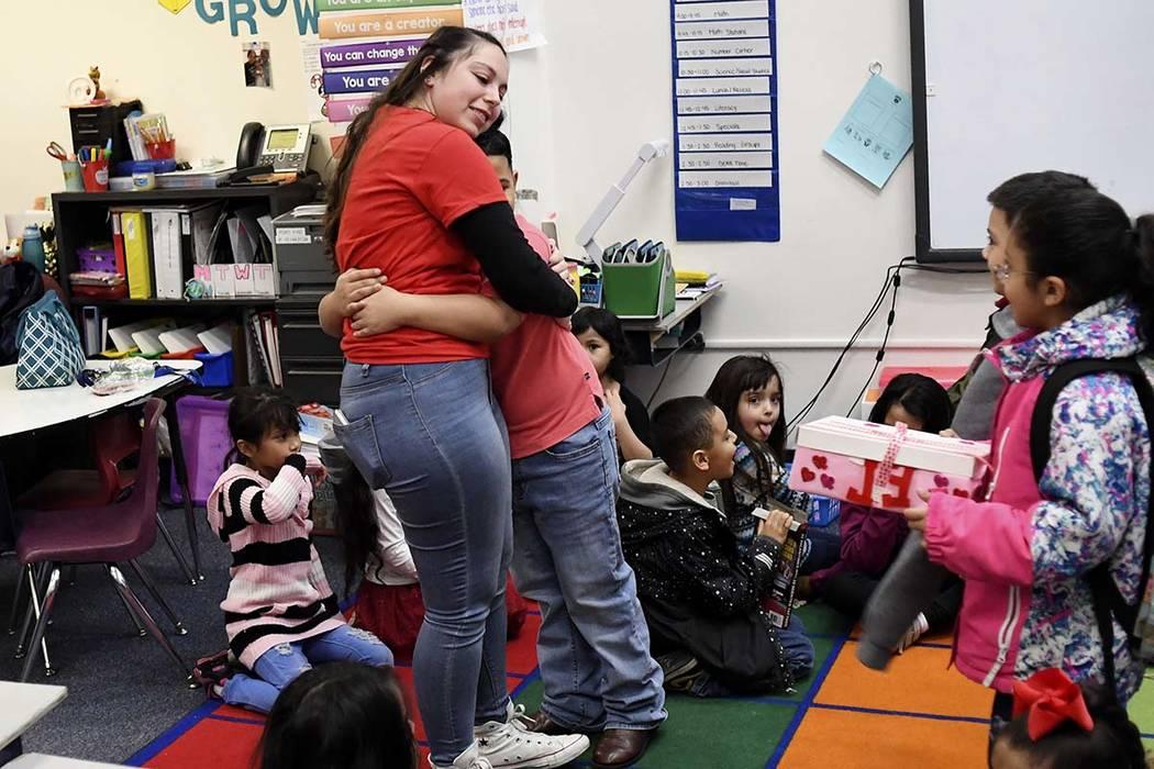 Hannah Maldonado, a first-grade teacher at Barnum Elementary, gets a hug from 7-year-old Jayden Gomez, welcoming her back to class, on Thursday, February 14, 2019 in Denver. (RJ Sangosti/The Denve ...