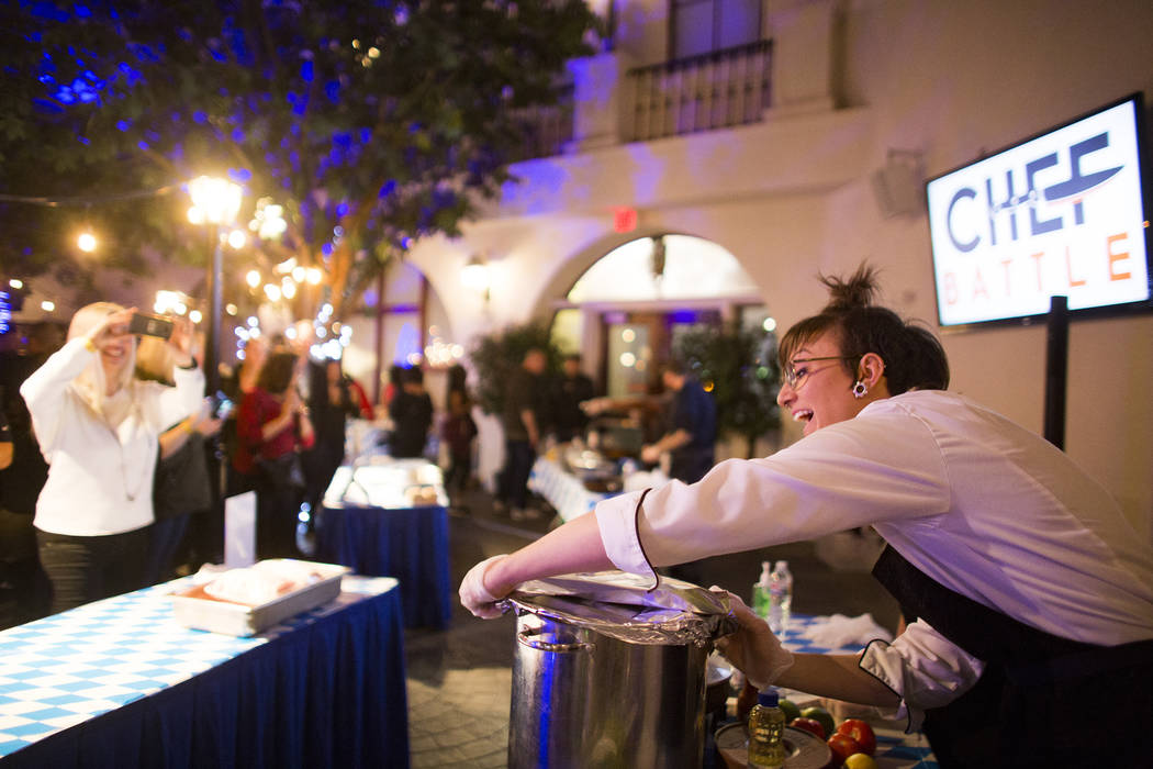 Chef Amanda Woodward, a banquet sous chef of the Cosmopolitan, works on her dish at the Chef Battle national cooking competition qualifier at HofbrŠuhaus in Las Vegas, Wednesday, Feb. 13, 20 ...