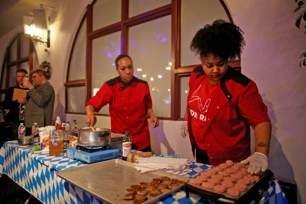Sous Chef Sameerah Winters, left, and Chef Amirah Brown, create their best dish as the crowd watches at the Chef Battle national cooking competition qualifier at HofbrŠuhaus in Las Vegas, We ...