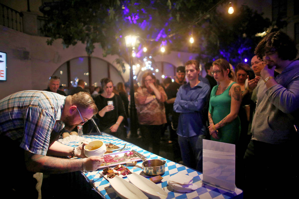 Chef Jon Vanhusen, chef of Tingle Labs, prepares a dish as the crowd watches at the Chef Battle national cooking competition qualifier at HofbrŠuhaus in Las Vegas, Wednesday, Feb. 13, 2019. ...