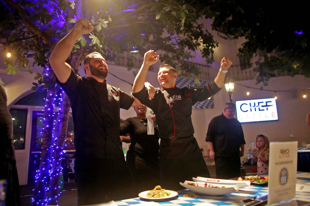 Chef Oscar Sanchez, right, and his Sous Chef Piera, left, celebrate after winning the Chef Battle national cooking competition qualifier at HofbrŠuhaus in Las Vegas, Wednesday, Feb. 13, 201 ...