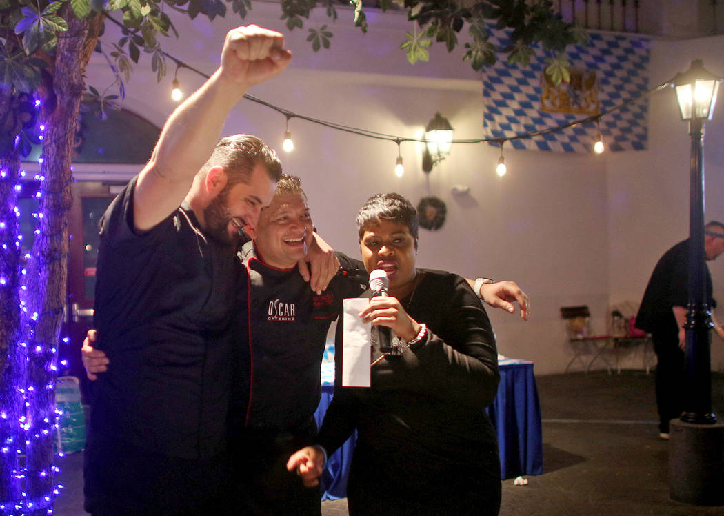 Chef Oscar Sanchez, center, and his Sous Chef Piera, left, speak to host Samantha Thomas after winning the Chef Battle national cooking competition qualifier at HofbrŠuhaus in Las Vegas, Wed ...