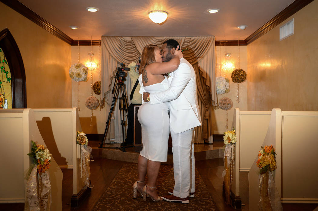 00bcd71fe6eb Emily and Brunsky Bruno from Atlanta kiss during their wedding ceremony at  Graceland Wedding Chapel in
