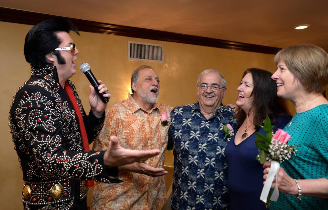 Elvis Presley impersonator Brendan Paul, left, sings with Robert Krencik, the best man, left, Robert Angellotti, the groom, Katherine Preble, the bridge, and Joanne Krenik, the maid of honor, duri ...