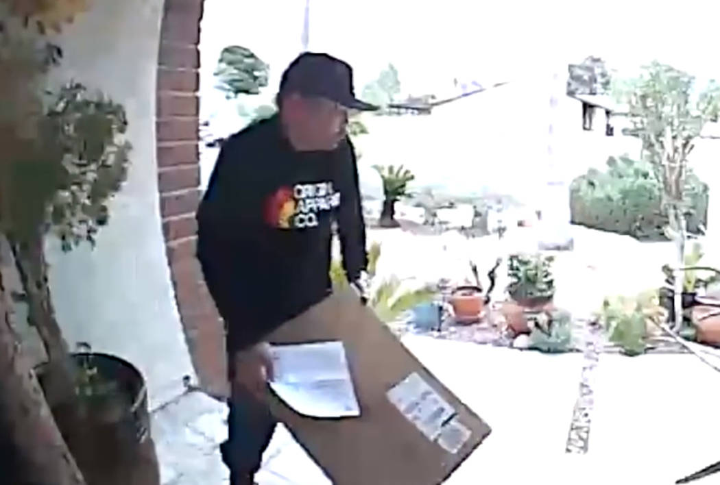 A package thief is captured on surveillance camera from the front porch of a residence located in the area of Oakey Boulevard and Torrey Pines Drive. (LVMPD)