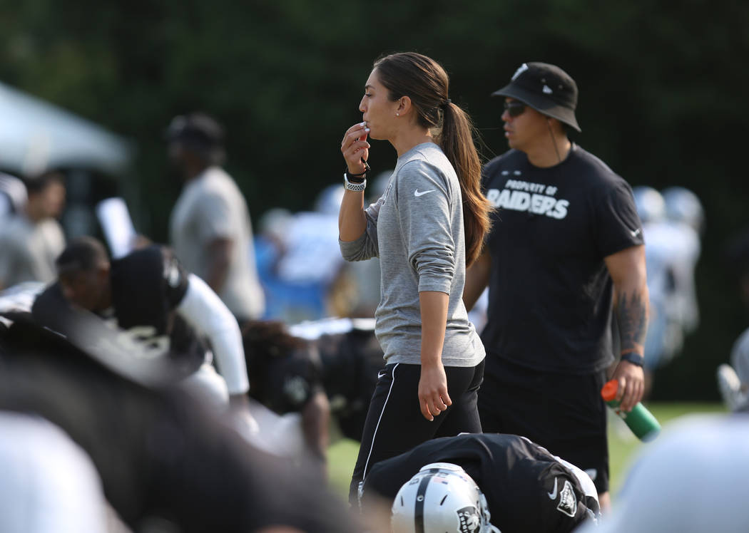 Oakland Raiders strength and conditioning assistant Kelsey Martinez runs the team's warm up drills at their NFL training camp in Napa, Calif., Tuesday, Aug. 7, 2018. Heidi Fang Las Vegas Rev ...