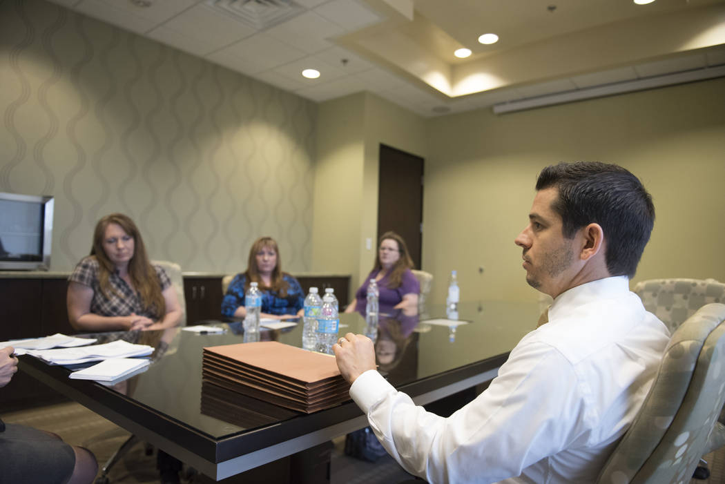 Attorney Gregory Coyer, right, and his clients, three sisters, from left, Kristine Fagone, Karen Jones and Jerilyn Bennett, speak with a reporter regarding their lawsuit against the Nevada Donor N ...