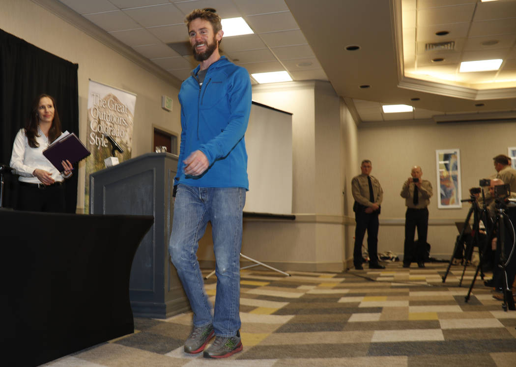 Travis Kauffman enters a news conference Thursday, Feb. 14, 2019, in Fort Collins, Colo., about his encounter with a mountain lion while running a trail just west of Fort Collins last week. (AP Ph ...