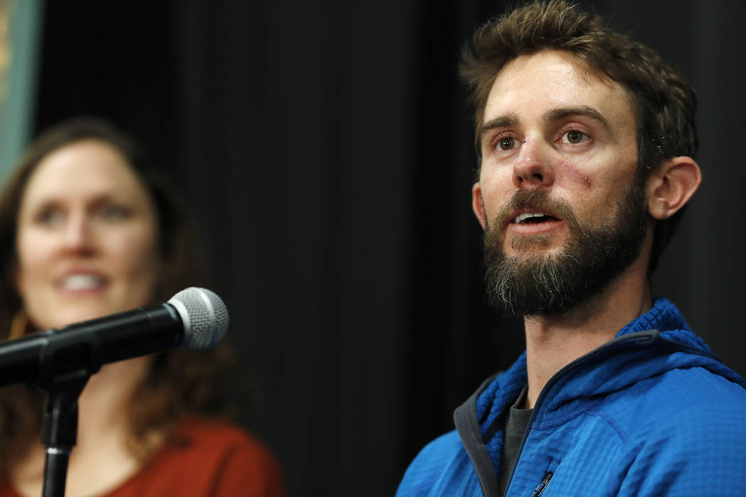 Travis Kauffman responds to questions during a news conference Thursday, Feb. 14, 2019, in Fort Collins, Colo., about his encounter with a mountain lion while running a trail just west of Fort Col ...