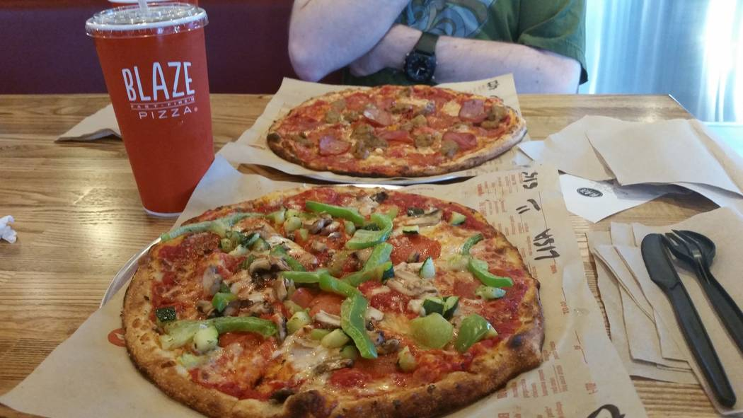 Custom-made pies are shown at Blaze Pizza, 10520 S. Eastern Ave. (Lisa Valentine/View)