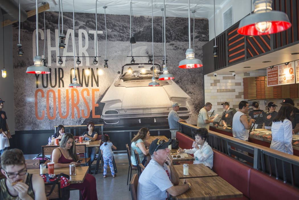Customers enjoy a free pizza during a celebration for the opening of Blaze Pizza's first local location at 10520 S. Eastern Ave. on Friday, May 29, 2015 in Henderson. (Jacob Kepler/Las Vegas Revie ...