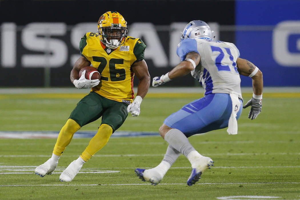 Arizona Hotshots running back Jhurell Pressley (26) runs in front of Salt Lake Stallions cornerback Cody Brown in the second half during an AAF football game Sunday, Feb. 10, 2019, in Tempe, Ariz. ...