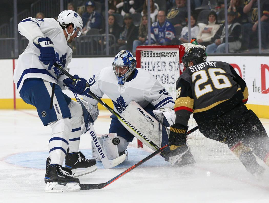 Toronto Maple Leafs goaltender Frederik Andersen (31) blocks a shot from the Vegas Golden Knights as Toronto Maple Leafs defenseman Ron Hainsey (2) and Vegas Golden Knights center Paul Stastny (26 ...