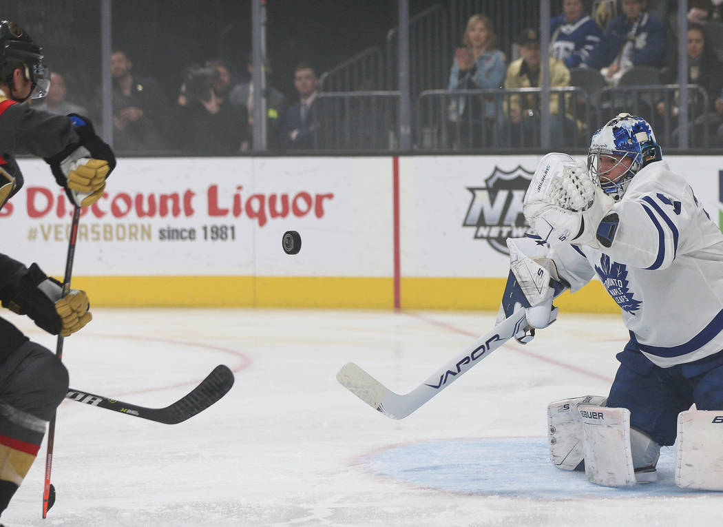 Toronto Maple Leafs goaltender Frederik Andersen (31) gets ready to block a shot from the Vegas Golden Knights during the first period of an NHL hockey game at T-Mobile Arena in Las Vegas, Thursda ...