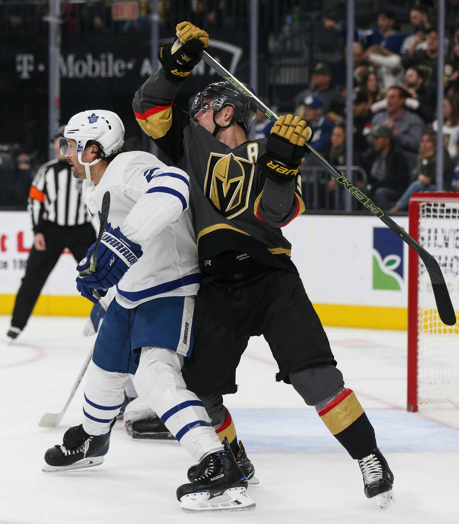 Toronto Maple Leafs defenseman Ron Hainsey (2) blocks Vegas Golden Knights right wing Reilly Smith (19) from getting open during the first period of an NHL hockey game at T-Mobile Arena in Las Veg ...