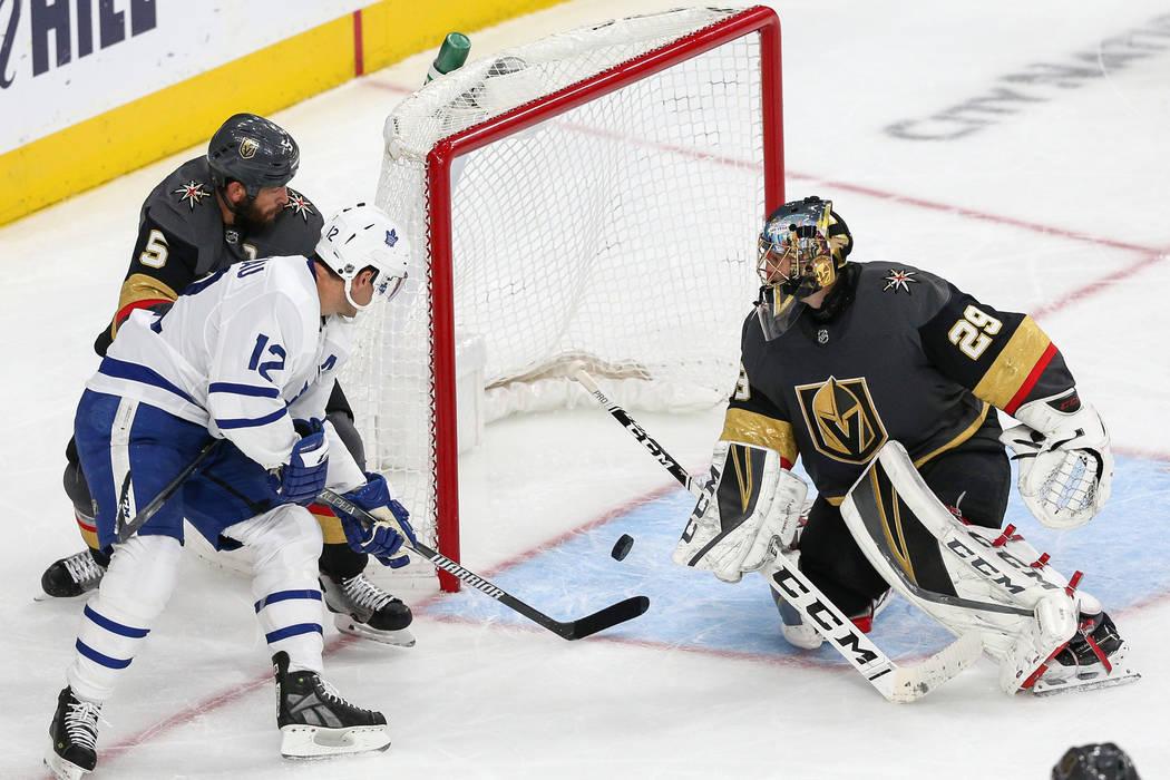 Toronto Maple Leafs center Patrick Marleau (12) scores against Vegas Golden Knights goaltender Marc-Andre Fleury (29) while being guarded by Vegas Golden Knights defenseman Deryk Engelland (5) dur ...
