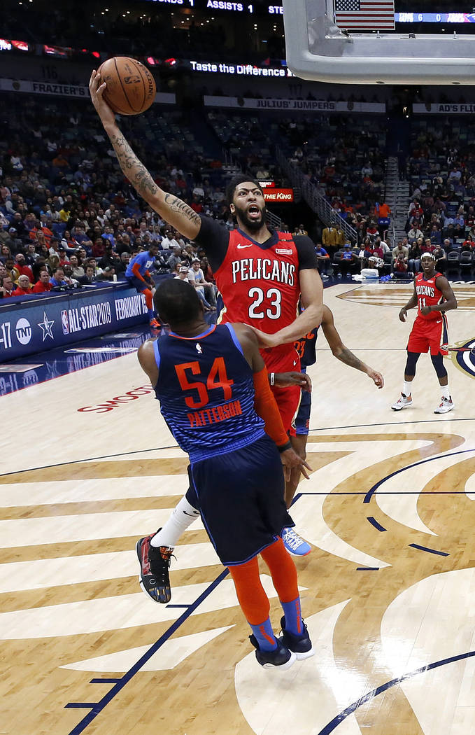 New Orleans Pelicans forward Anthony Davis (23) drives to the basket past Oklahoma City Thunder forward Patrick Patterson (54) during the second half of an NBA basketball game in New Orleans, Thur ...