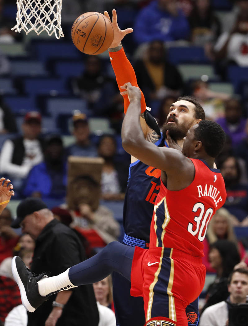 Oklahoma City Thunder center Steven Adams (12) blocks a shot from New Orleans Pelicans center Julius Randle (30) during the first half of an NBA basketball game in New Orleans, Thursday, Feb. 14, ...