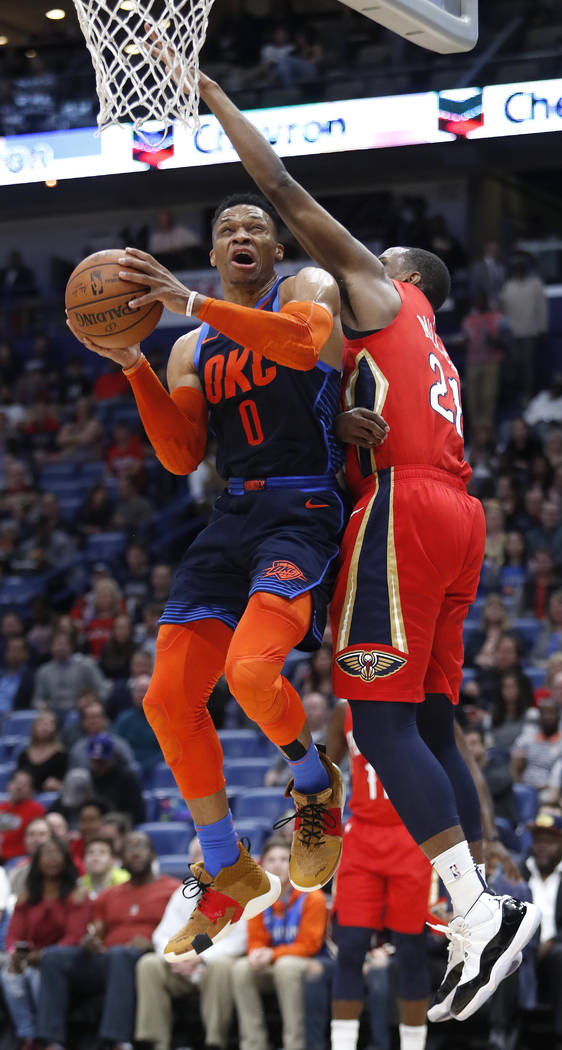 Oklahoma City Thunder guard Russell Westbrook (0) drives to the basket past New Orleans Pelicans forward Darius Miller (21) during the first half of an NBA basketball game in New Orleans, Thursday ...