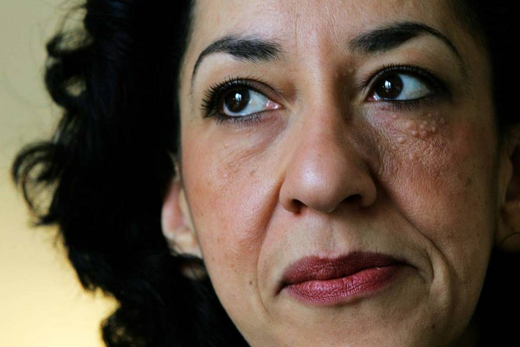 In this Wednesday, Feb. 23, 2005 file photo, British author Andrea Levy at home in north London. Levy has died after suffering from cancer in recent years. She was 62. (AP Photo/Alastair Grant, File)