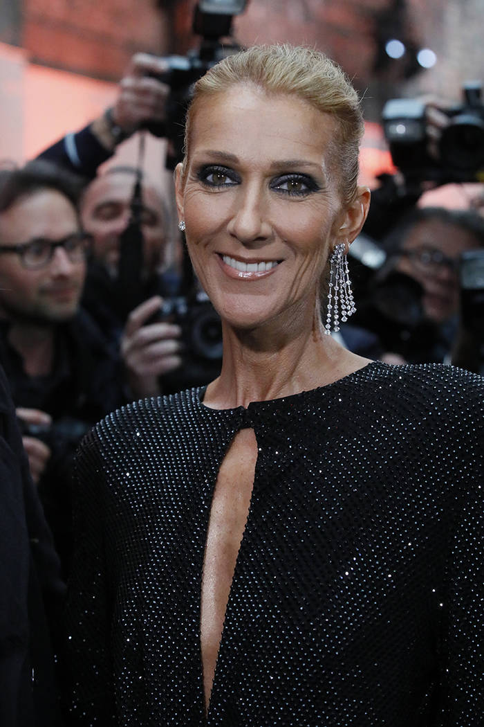 Singer Celine Dion arrives for the Vauthier Spring/Summer 2019 Haute Couture fashion collection presented in Paris, Tuesday Jan. 22, 2019. (AP Photo/Francois Mori)