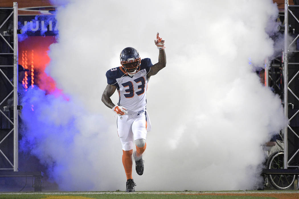 Orlando Apollos safety Will Hill III runs onto the field during player introductions for the team's Alliance of American Football game against the Atlanta Legends on Saturday, Feb. 9, 2019, in Orl ...