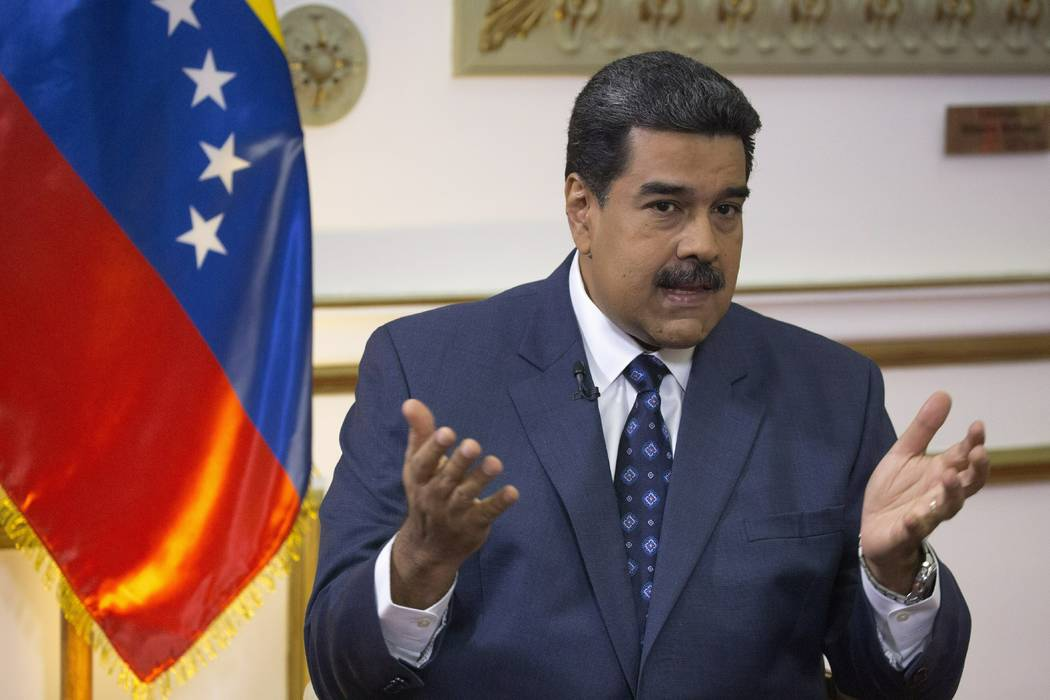 Venezuela's President Nicolas Maduro speaks during an interview with The Associated Press at Miraflores presidential palace in Caracas, Venezuela, Thursday, Feb. 14, 2019. Even while criticizing D ...