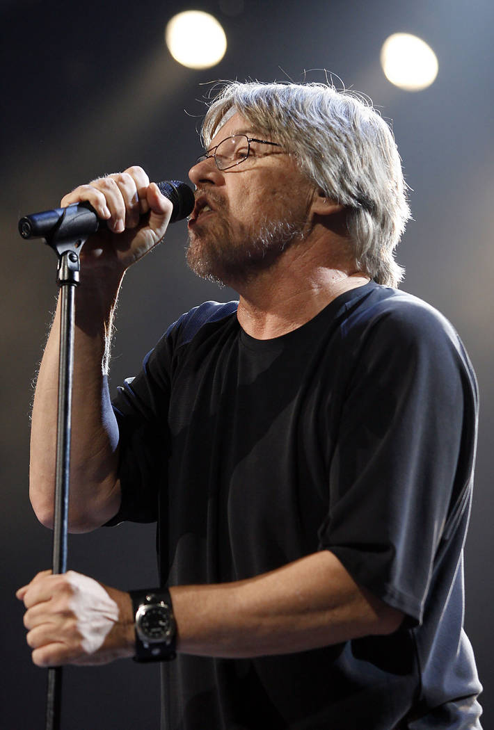 """Bob Seger performs with The Silver Bullet Band during his """"Face The Promise"""" tour stop at the Palace of Auburn Hills, Mich., Wednesday, Dec. 20, 2006. (AP Photo/Gary Malerba)"""