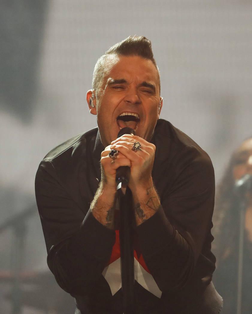 English singer Robbie Williams performs during the Corona Capital music festival in Mexico City, Saturday, Nov. 17, 2018. (AP Photo/Eduardo Verdugo)
