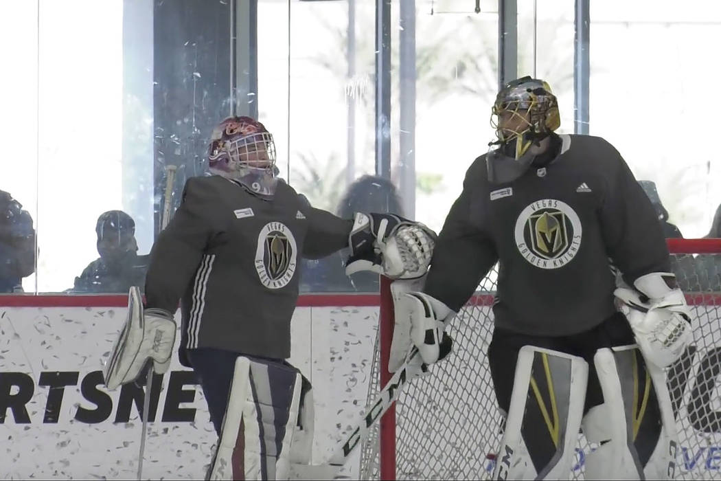 Vegas Golden Knights goaltender Marc-Andre Fleury, right, talks with honorary Golden Knights player Jay Procter, 12, during a practice at City National Arena in Las Vegas, Friday, Feb. 15, 2019. ( ...